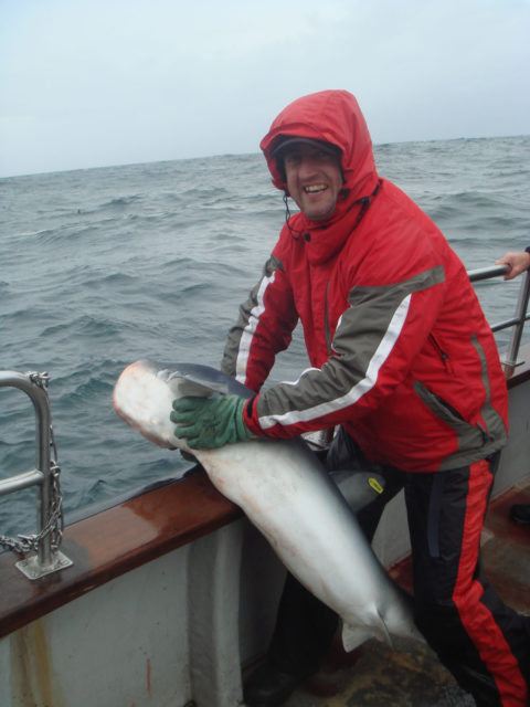 Anthony releasing his blue shark. This fish was a bit camera shy, but it still wins him Catch of the Week