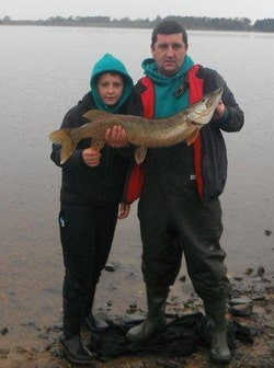 Paddy Ashe gets a helping hand with his 14lb prize winning pike from his son Nathan aged 12