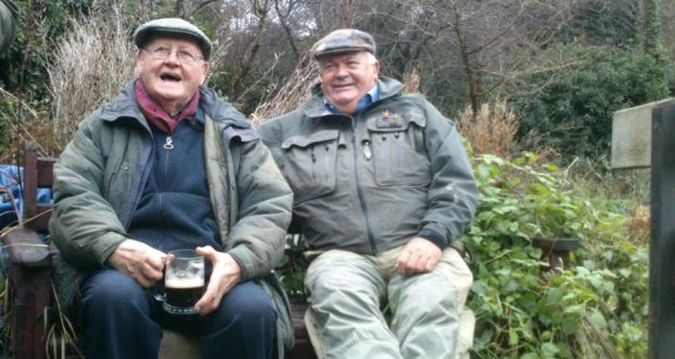 Drowning their sorrows on the flooded River Liffey at Islandbridge on New Year's Day, were Dublin and District Salmon Anglers' chairman Eugene McGrattan (left) and club member Paddy Murray