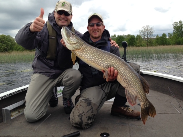 Marco Pirola with the biggest pike (113cm) of his first Ireland trip pictured with guide Bodo Funke
