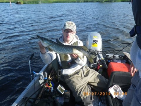 Pawel Orlow With A Pike from the River Shannon