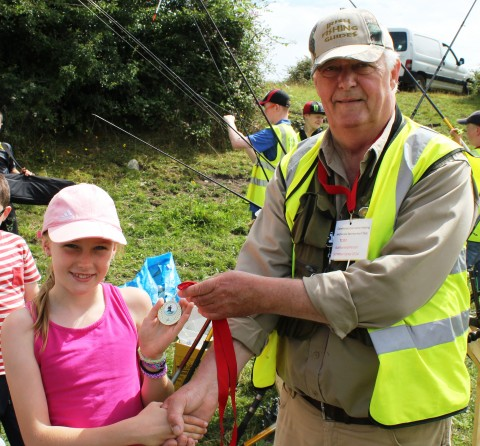This Young Angler Receives  Her Medal for Third Place