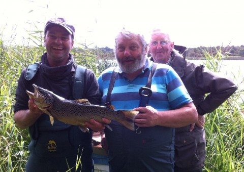 Pat Daly with Glore trout, Chairman Eddie O, Donnell and Kevin