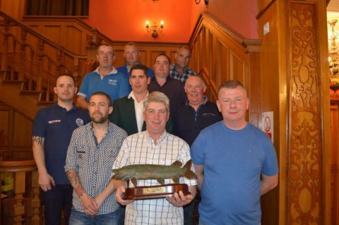 Dave Murphy with the winning trophy along with the nine other winners.