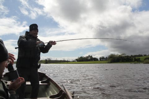 Carefully playing a big pike on a big lough in Co. Cavan.