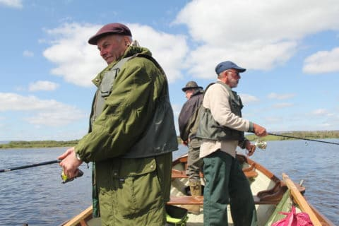 """Three of the French """"Foresters"""" anglers enjoying fishing for pike in Co. Cavan."""