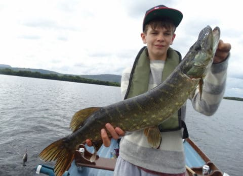 15 year aold Lawrence Davies with his ferst ever Irish pike