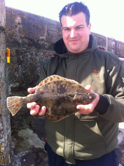 Daniel Burr with a nice flounder caught during a recent session on Mulranny Pier, Co. Mayo