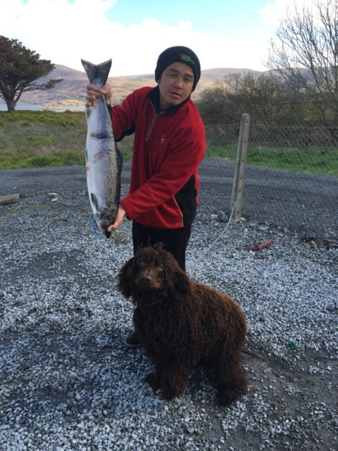 Tham with his Hound and fine catch 10 1/2 lbs. Salmon.