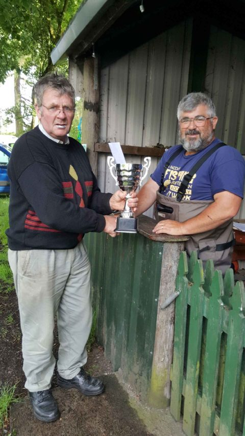 Lene winner Mick Corrigan receives the Paddy Dolan trophy from Pat Brown L.L.A.A