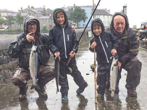 Three generations of the Cosgrove family - from left, Michael, with sons Blair & Conor with Grandad Henry, who enjoyed their day in the rain at the Galway Fishery!