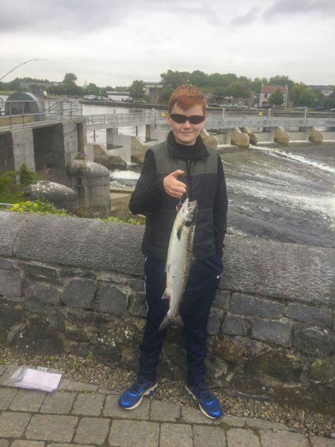 Young David Donoghue with his first ever salmon from the Galway Fishery