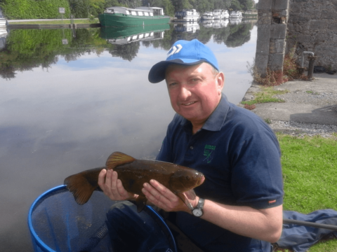 A happy angler with his catch new Shannon Harbour Co.Offaly