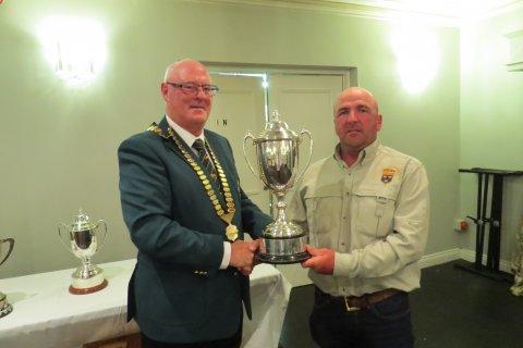 President John Deacy presents the top rod trophy to Seamus O Loughlin