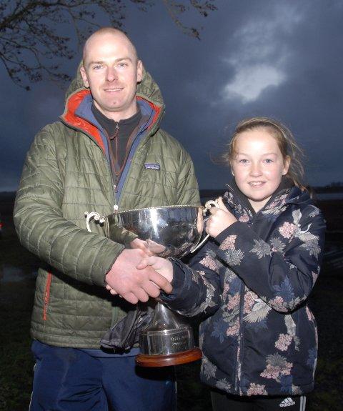 Ciaran Newman receives the Moffatt Cup from Shannon Breslin.   Grandaughter of the late Philip Moffatt.