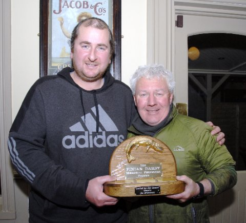 Barry Darby son of the late Finian presents Mic k Flanagan  with the trophy