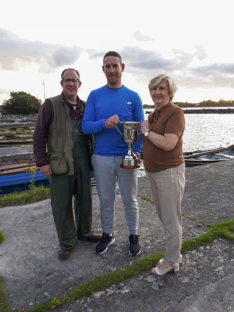 Willie Cullinane receiving the trophy from Mary Tighe, wife of the late Tony, and Noel O'Toole, chairman
