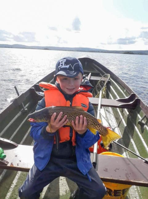 Harry O'Toole looks happy with his fine trout. Well done Harry!