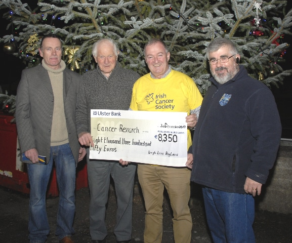 Declan Leonard accepts Cheque for irish Cancer Sociaty from Lough Lene Angling Association Chairman Tom Fagan, also in photograph is Andy Cosgrove Lene treasure, and pat Browne lene Competition Captain.