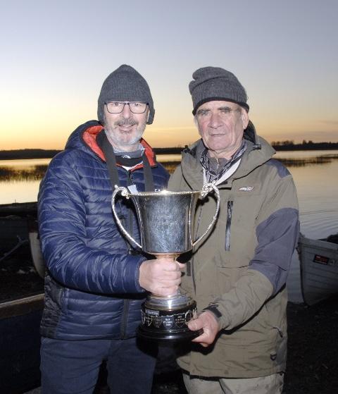 Weir Cup stays in Multyfarnham. Pat Weir presents Christy Cox of Multyfarnham with Weir Cup.