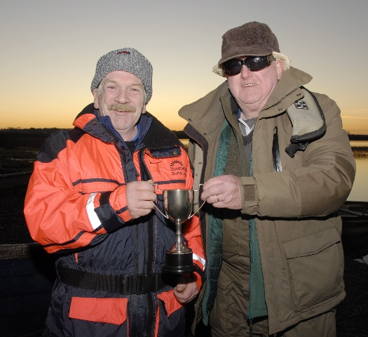 Joe Ledwith was top pike angler in 2019 on Derravaragh . presenting prize is Frank McKeon.