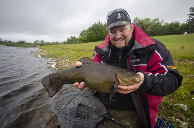Angler with large tench