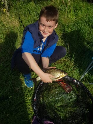 Aaron and his first bream