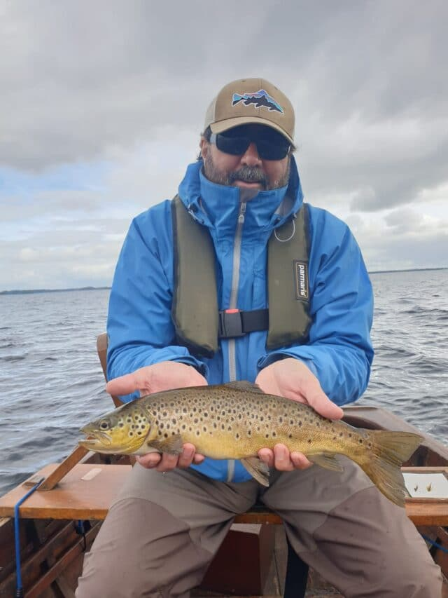 Angler holding trout