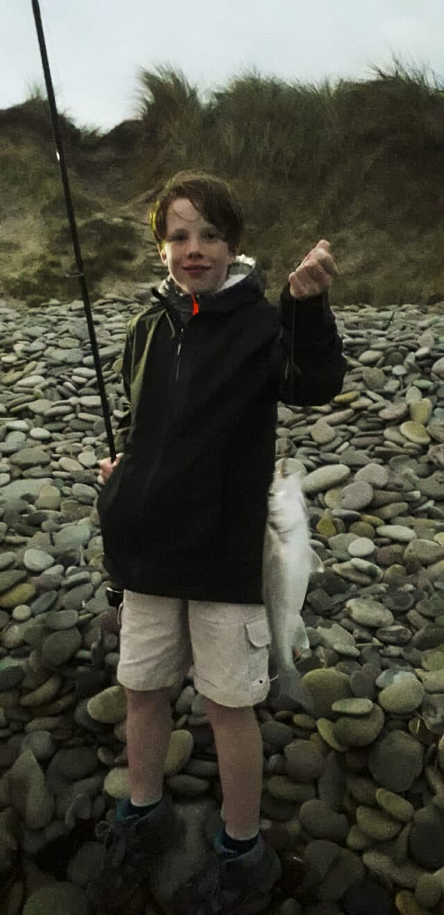 Young angler holding a bass