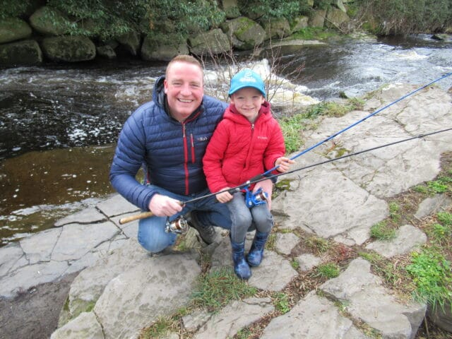 Father and son fish on the River Dodder on opening day