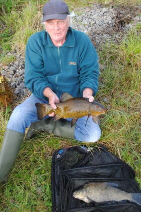 Dave with a bonus Tench from his catch, which included Bream and Roach