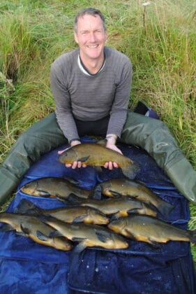 Martyn with some nice Tench from his catch